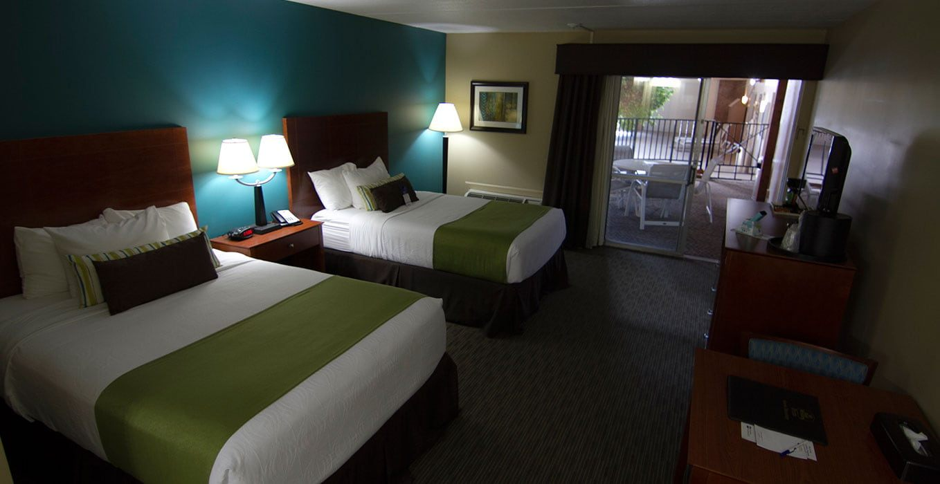 We Offer Poolside Rooms That Feature Patios, Large Flat Screen TVs With  Cable Channels And Two Double Beds. Other Conveniences Include A Microwave,  ...